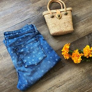 Gap jeans with white flowers.